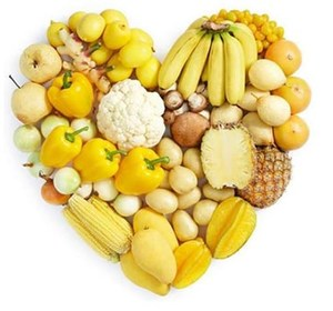Assortment of yellow foods in heart shape