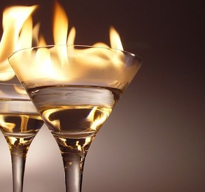 A pair of flaming cocktails