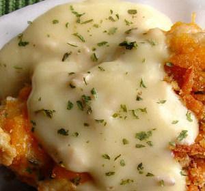 Crispy cheddar chicken on plate with cream of chicken sauce