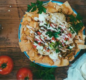 Shawarma nachos loaded up on a plate