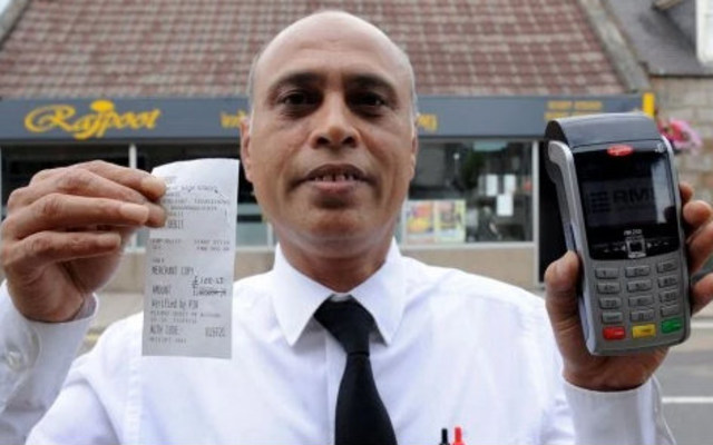 Restaurant owner Abdul Wahid holding the very expensive transaction