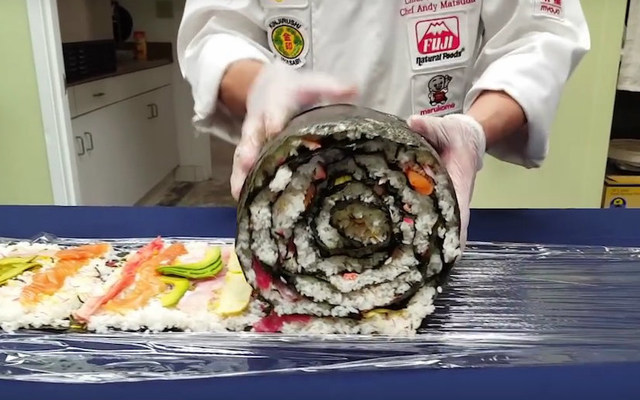 a genius rolls together the ultimate giant sushi roll of our dreams