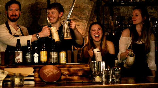 """People enjoying themselves at a """"Game of Thrones"""" bar"""