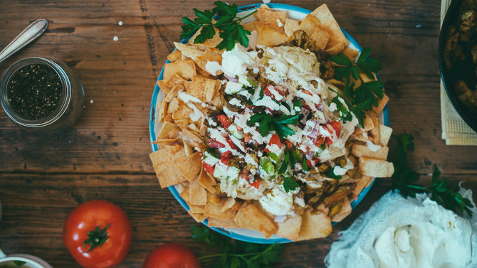 Shawarma nachos loaded up on a plate