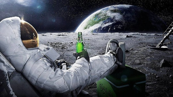 An astronaut kicking back on the moon with a beer